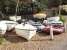 A selection of used GRP, wooden tenders, inflatables and canoes.